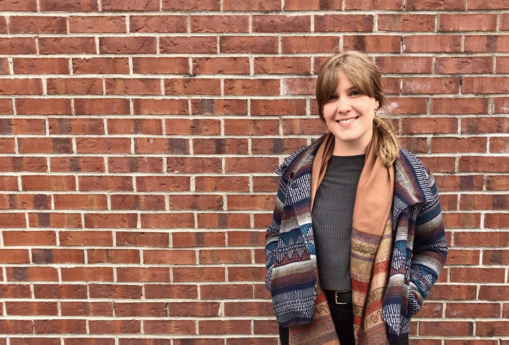 Photo of Carlene Kurdziel against brick wall - Freelance writer for SaaS and tech brands